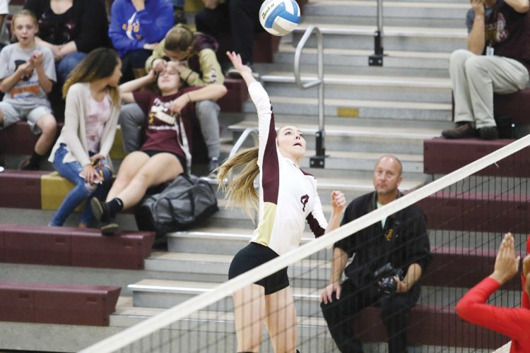 Photo courtesy of Sean Arbaut Minot High's Elise Klein (4) goes for a kill during a high school volleyball match Tuesday at Minot High.