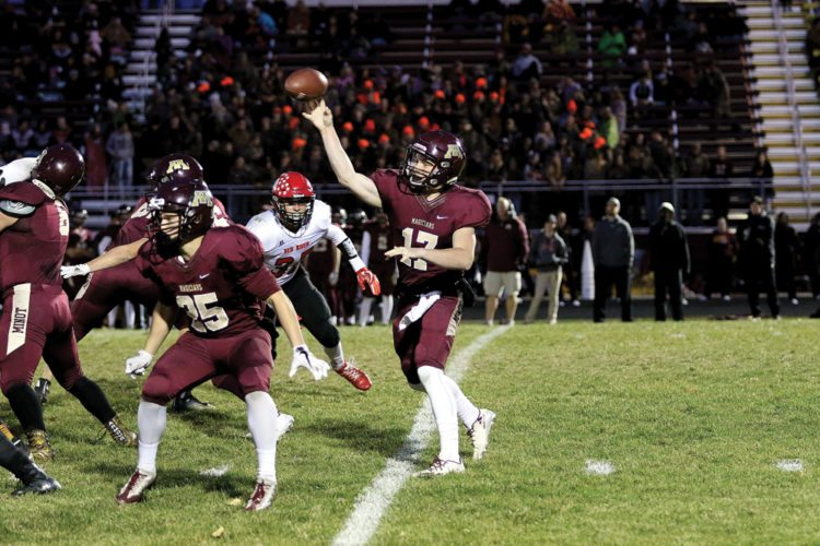 Submitted Photo Minot High's Creighton Rudolph (17) throws a pass downfield during a high school football game Wednesday at Duane Carlson Stadium in Minot. Photo courtesy of Sean Arbaut.