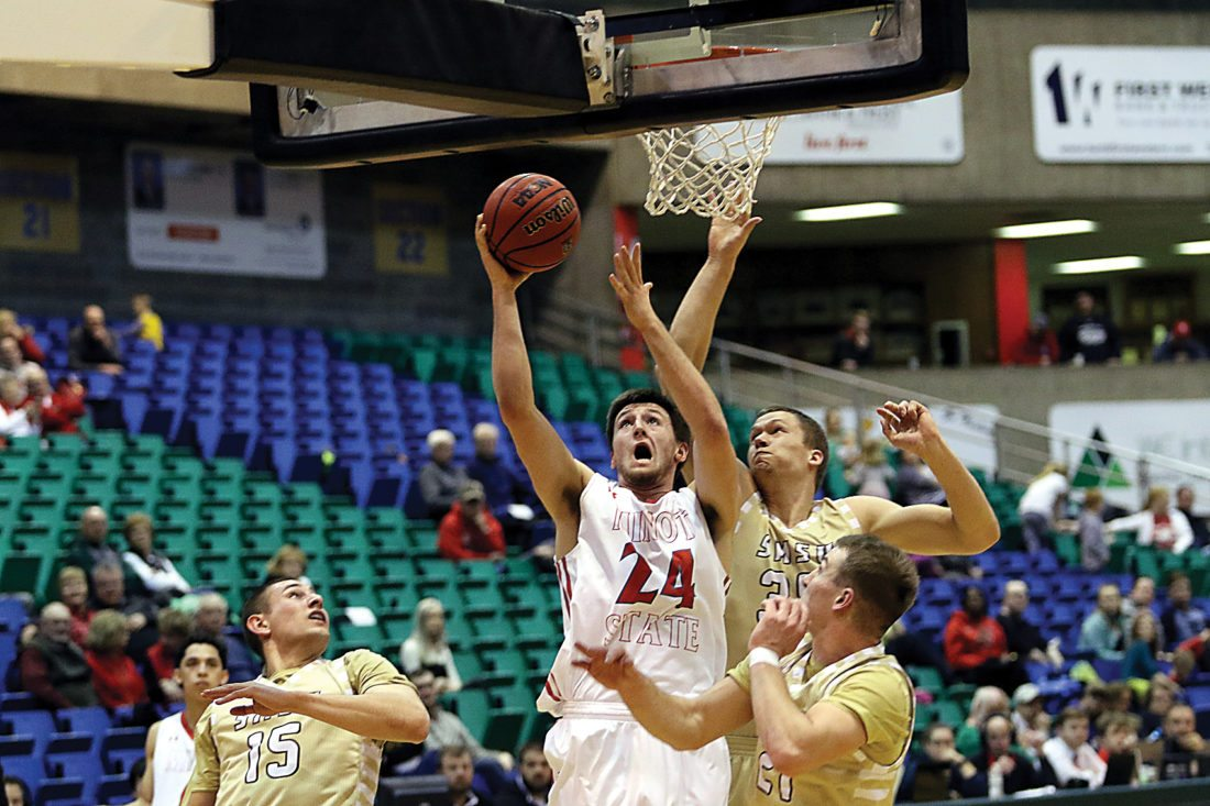 Sean Arbaut/Minot State athletics  Minot State's Tyler Rudolph (24) tries to convert a layup during a men's college basketball game last season.