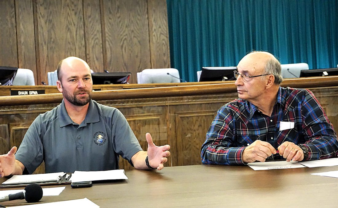 Jill Schramm/MDN Nuisance animal committee member Greg Gullickson, left, talks about animal management at a meeting Wednesday as committee member Dwayne Walz listens at right.