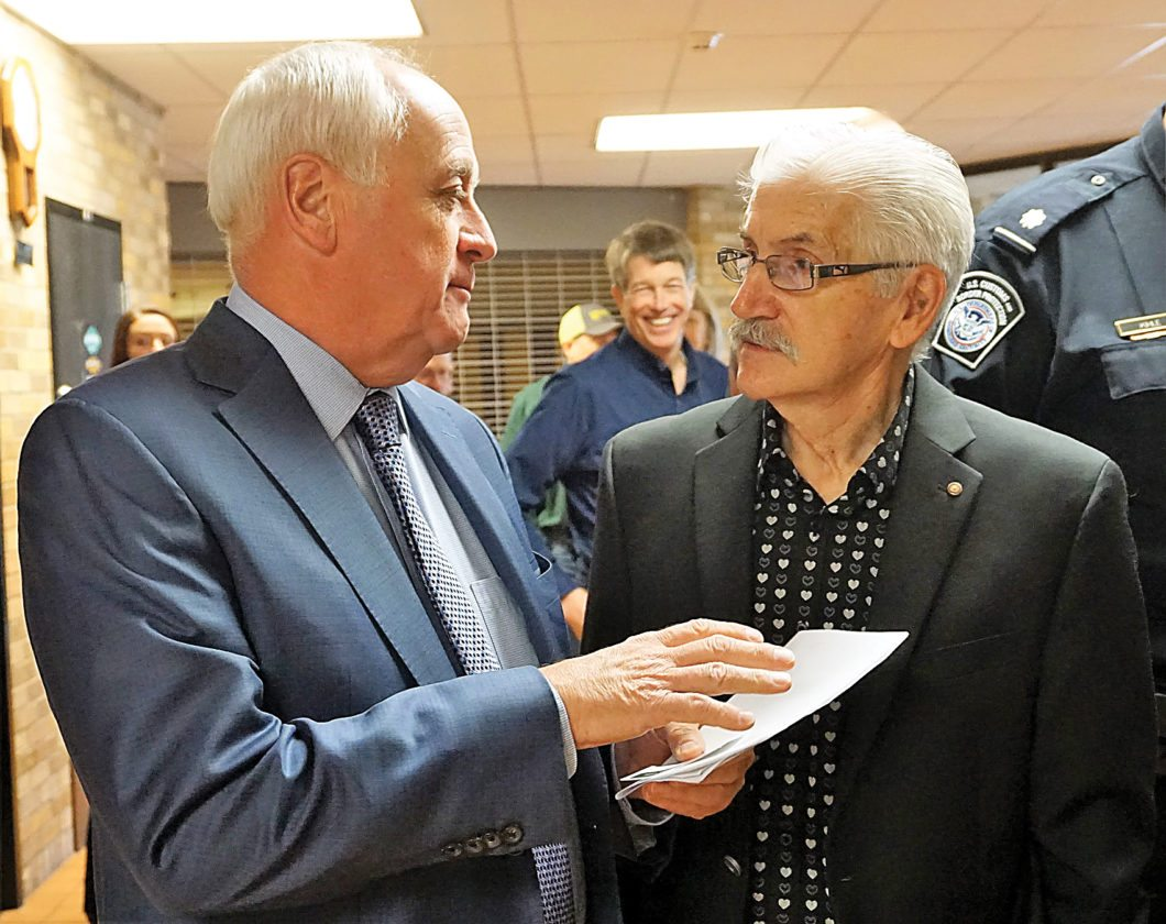 Jill Schramm/MDN David Marit, minister of Highways & Infrastructure in Saskatchewan, left, visits with Dennis Moore, Estevan, of Southeast Sask Transportation Group in Kenmare Thursday.
