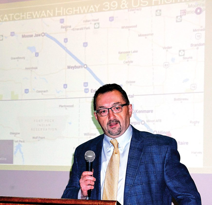 Jill Schramm/MDN Thomas Sorel, director of the North Dakota Department of Transportation, stands in front of a highway map as he speaks at the U.S. Highway 52/Provincial 39 Summit in Kenmare Thursday.