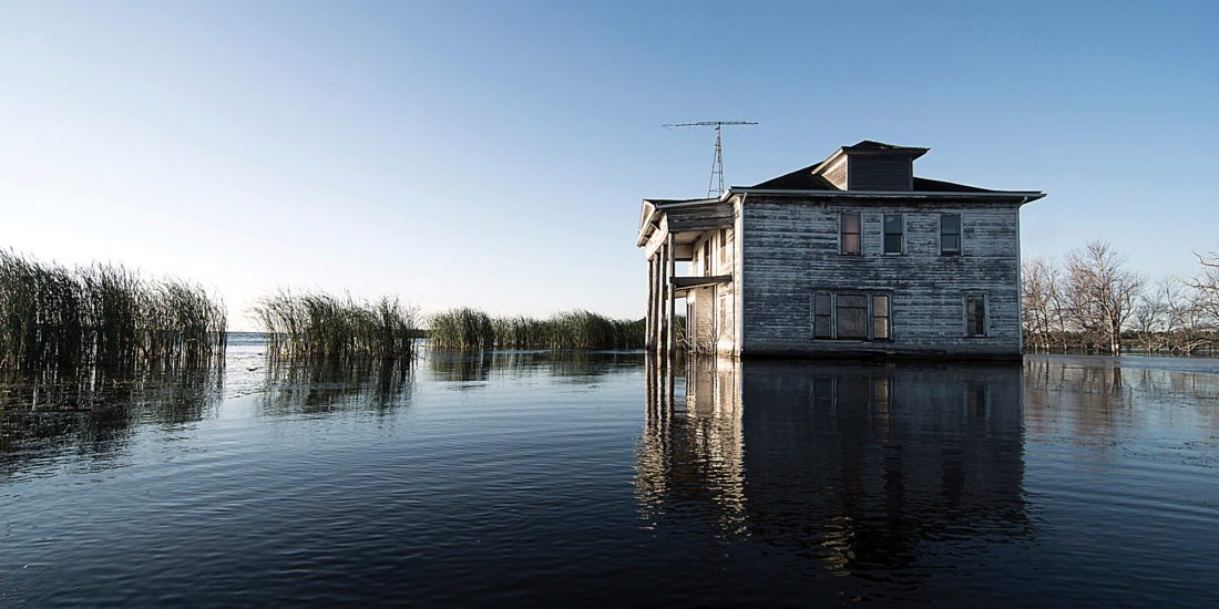 Submitted Photo Houses and barns have slowly been swallowed up by the ever growing Devils Lake.  Within this lake is believed to be the Devils Lake Monster, a serpent with alligator jaws, glaring red eyes and an 80 foot long tail