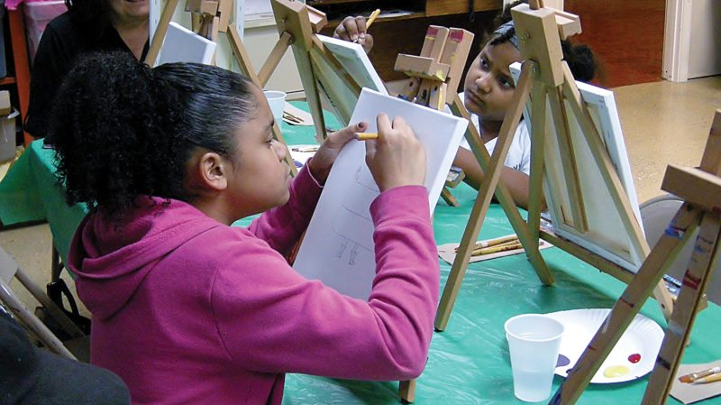 Kiera Aguilar, 10, foreground, and Aaliyah Hicks, 7, draw pictures of candy corn during Family Paint Saturday at the Taube Museum of Art on Saturday. The girls were drawing from a model, pictured.  Family Paint Saturday is held one Saturday a month at the museum in downtown Minot. Each monthly session is $18 for nonmembers and $16 for members, per person, which includes all the supplies needed to create a 9-inch by 12-inch canvas masterpiece. Each session will be held at the Taube Museum of Art from 1:30 p.m. to 2:30 p.m. More information can be found at www.taubemuseum.org  Photos by Andrea Johnson/MDN