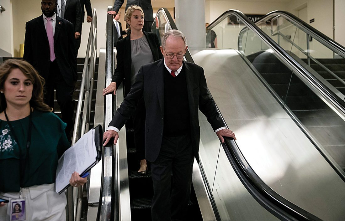 AP Photo Sen. Lamar Alexander, R-Tenn., takes the escalator down as he returns to his office after appearing on the Senate floor with Sen. Patty Murray, D-Wash., to defend their bipartisan proposal for resuming federal subsidies to health insurers that President Donald Trump has blocked, at the Capitol in Washington, Thursday.