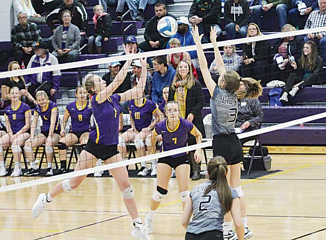 Ashton Gerard/MDN Bishop Ryan's Nora Kramer (3) goes to block Glenburn's Sierra Hansen's (1) hit Thursday during the District 12 Tournament at Lewis & Clark Berthold High School.
