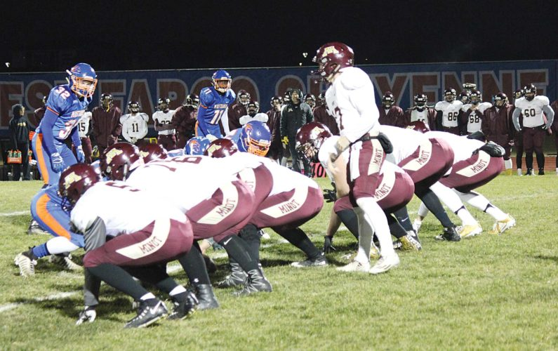 Alex Eisen/MDN The offensive line of Minot High and the defensive line of West Fargo Sheyenne prepare to engage in the first quarter of a first round Class 11AAA playoff game at West Fargo Sheyenne.