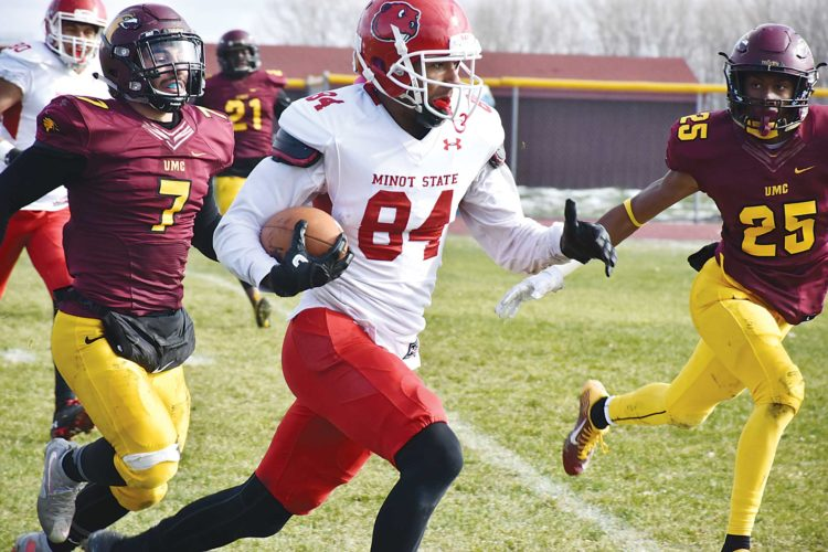 Farhan Mohamed/Special to the MDN Minot State wideout Ray Watkins (84) runs with the ball in open field Saturday.