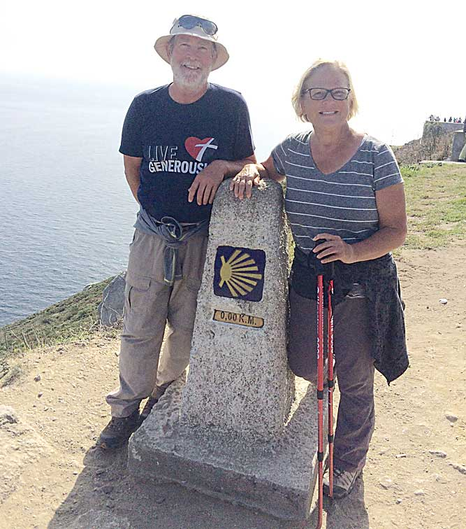 Submitted Photo Terry and Kathy Thiel standing at a pillar labeled 0.0 K.M., signifying the end of their 560-mile journey.