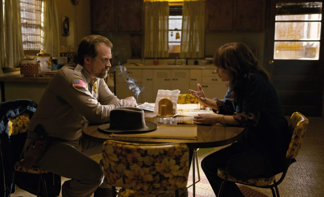 "This image released by Netflix shows David Harbour, left, and Winona Ryder in a scene from ""Stranger Things."""