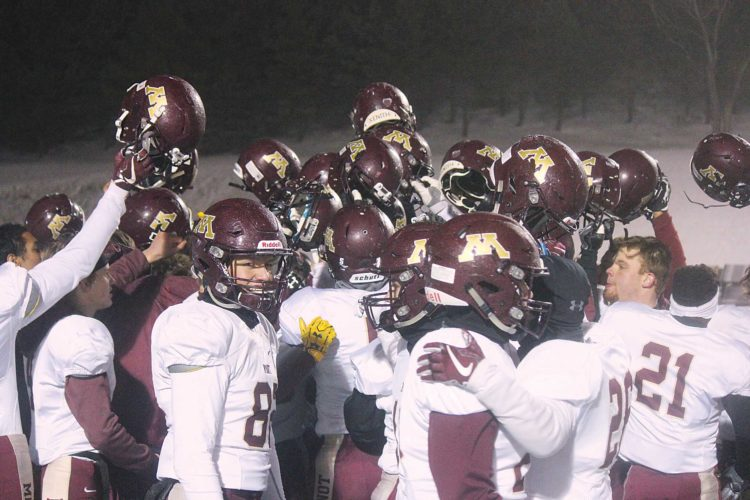 Alex Eisen/MDN The Minot High School football breaks from its huddle after beating Century 14-10 in the Class 11AAA state semifinals in Bismarck.