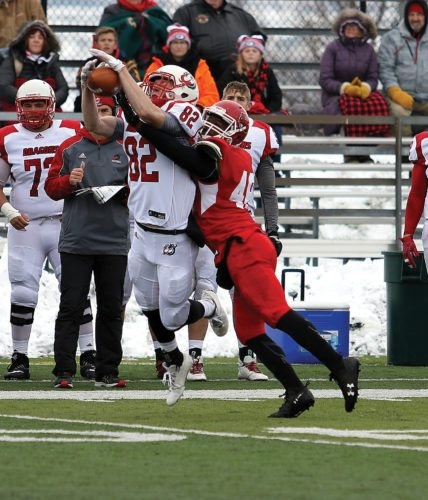 Sean Arbaut/Minot State athletics  Minot State defensive back Manuel Bradford (48) breaks up a pass intended for Moorhead wideout Hayden Swartz (82) at a college football game Saturday at Herb Parker Stadium.