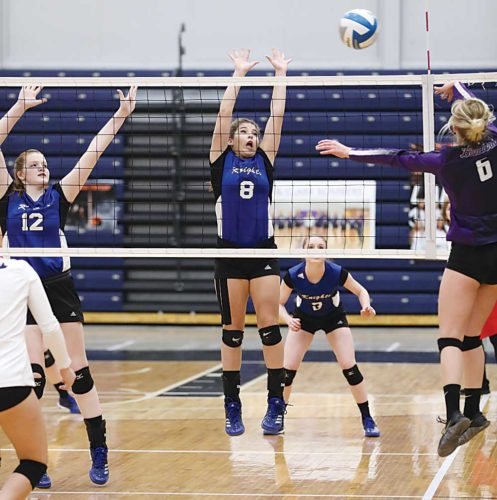 Photos courtesy of Al Christianson ORCS outside hitter Ryleigh Popinga (8) leaps in the air while attempting to record a block during the Region 6 volleyball tournament Tuesday in Minot.