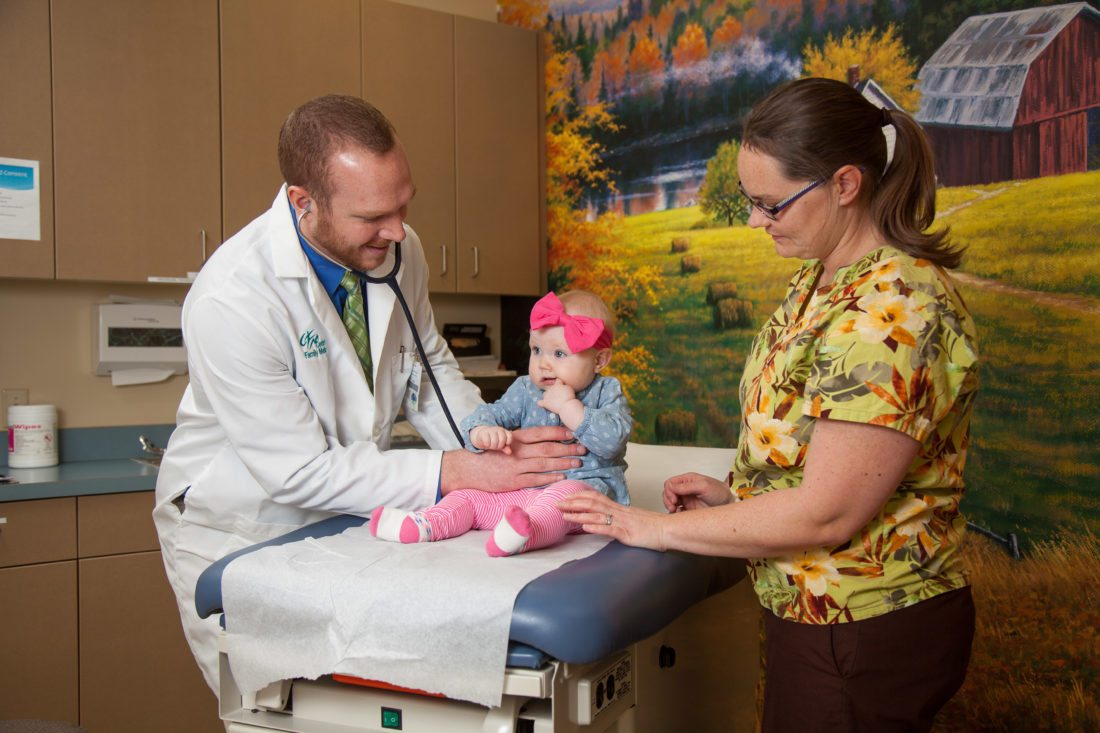 Submitted Photo Dr. John Folland cares for patients at the UND Center for Family Medicine in Minot.