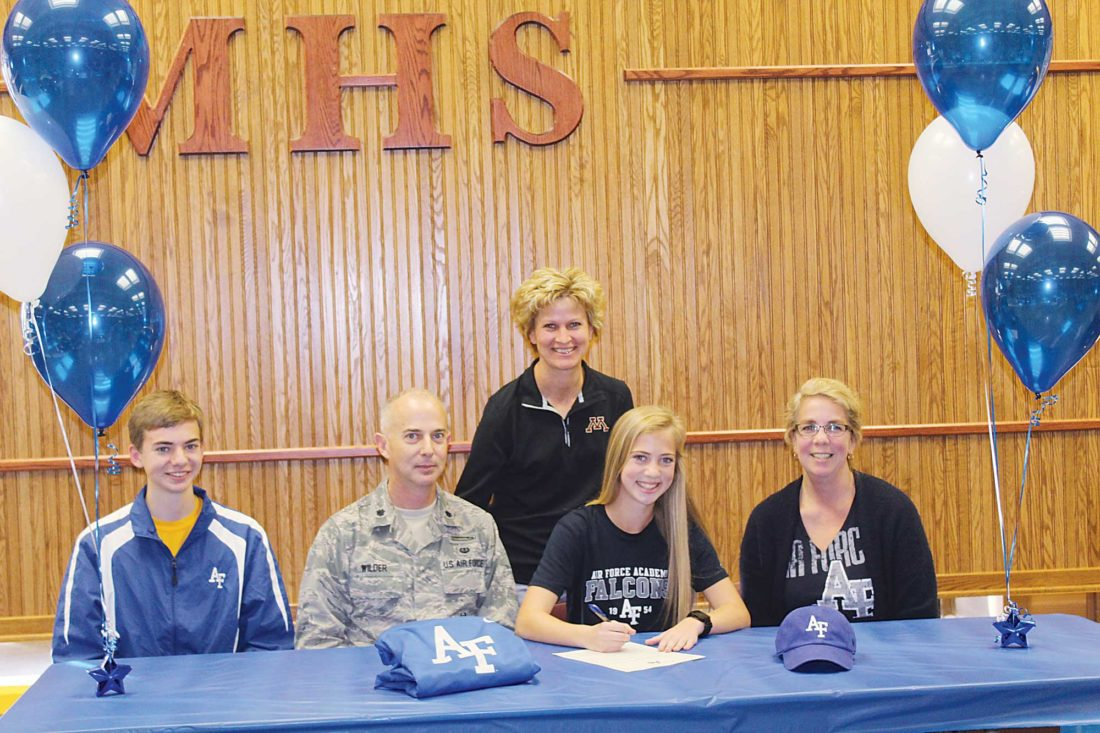 Ashton Gerard/MDN Adrianna Wilder signed with U.S. Air Force Academy Falcons Wednesday and posed for a picture at the Magic City Campus Thursday. From left is Wilder's brother, father, coach Carla Wahlund, Adrianna Wilder and her mother.