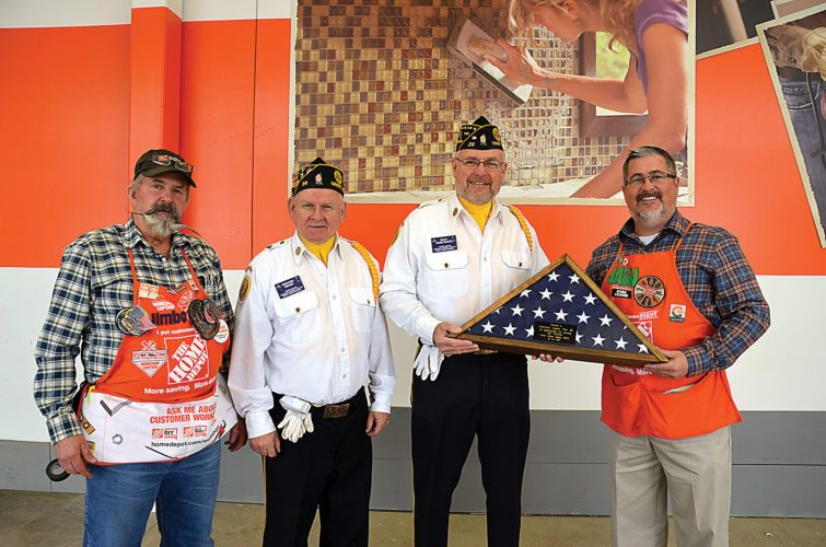 """Eloise Ogden/MDN Representatives of the Home Depot store in Minot presented the Minot American Legion Post No. 26 Honor Guard with a folded U.S. flag in a case on Friday to show Home Depot's appreciation for serving veterans. An enscription with the flag and case said it is """"in appreciation for serving our Veterans."""" From the left are: Jimbo Morris, Minot Home Depot workshop captain who works in the Electrical Department; Richard Reuer and Dean Verstraete, Minot American Legion Honor Guard members; and Jason Barker, Minot Home Depot store manager. A folded U.S. flag in a case was also presented to the Honor Guard of the Minot Veterans of Foreign Wars Post 753 commanded by Loren Headrick."""