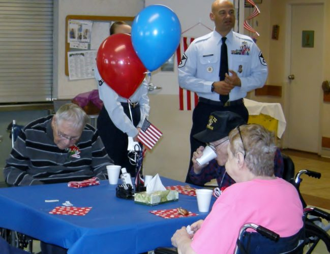 Andrea Johnson/MDN Minot Health and Rehab residents and veterans Mary Weber, Walter Kreie and Melvin Jenrsud enjoy coffee and doughnuts during a celebration of veterans on Friday. In the background are Air Force Airman 1st Class Madison Cole and Master Sgt. Curtis Cockrell.