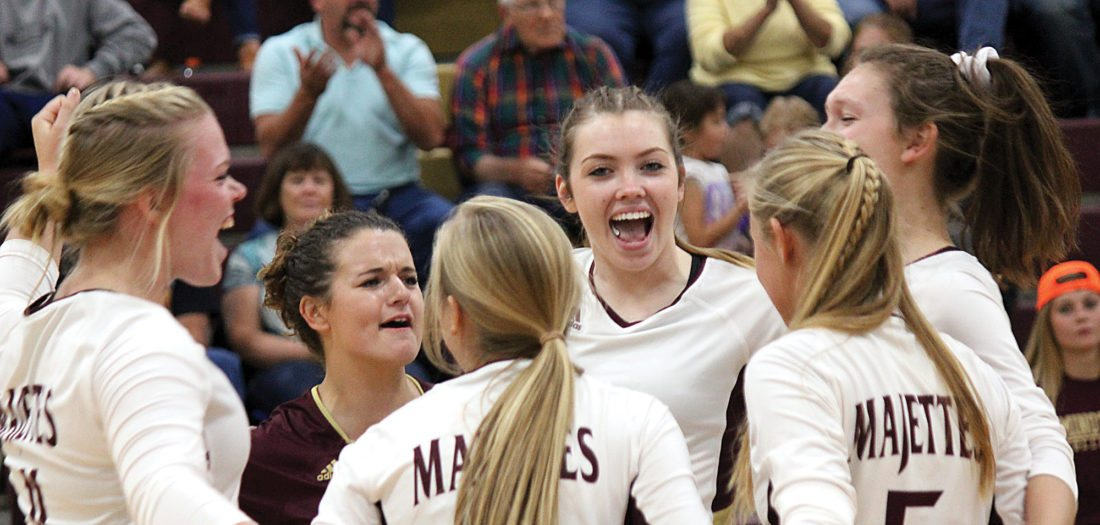 Alex Eisen/MDN The Minot High volleyball team celebrates after a point scored in a match earlier this season.