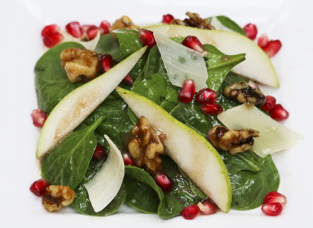 Spinach and pear salad with pomegranate vinaigrette.  Michael Vosburg / Forum Photo Editor