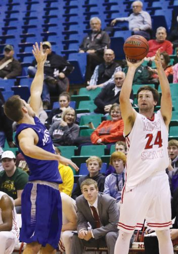 Sean Arbaut/Minot State athletics Minot State's Tyler Rudolph (24) shoots a 3-pointer during a college basketball game Tuesday at the MSU Dome.
