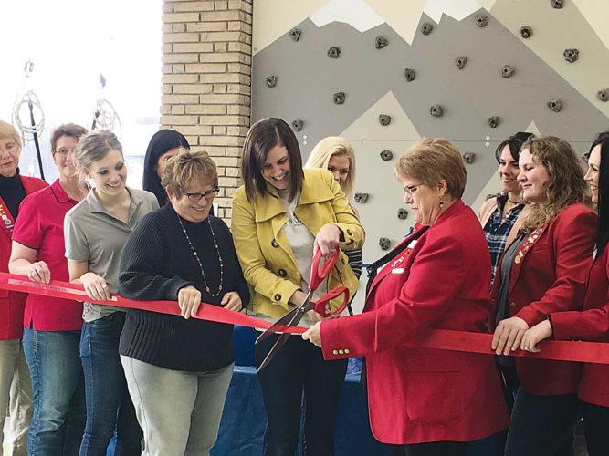 Shyanne Belzer/MDN Shannon Schmidt cuts the ribbon for the new sensory gym at Caleb's Clubhouse.