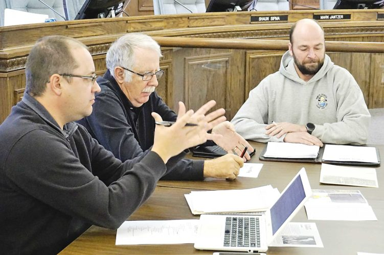 Jill Schramm/MDN Nuisance Animal Committee Chairman Josh Wolsky, left, addresses the committee Wednesday. Shown are members Chuck Emery and Greg Gullickson.