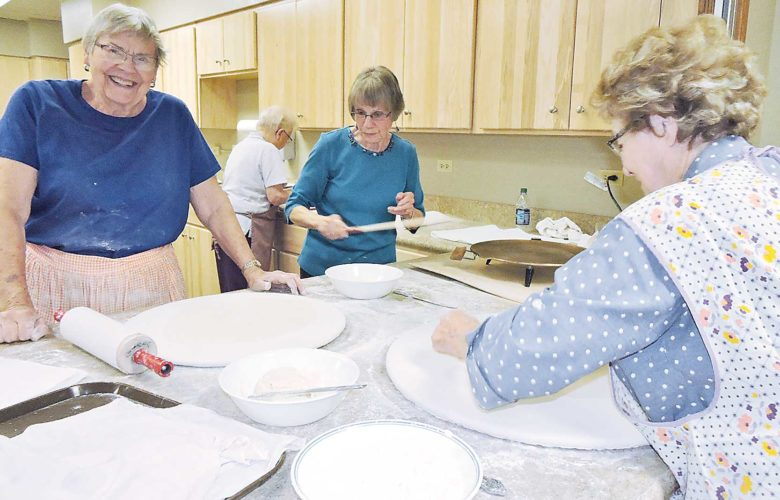 Kim Fundingsland/MDN Keeping a tasty Norwegian tradition alive, volunteers work at preparing lefse in the kitchen of Minot's Bethany Lutheran Church.