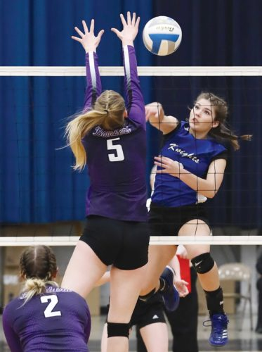 Our Redeemer's senior Ryleigh Popinga attacks the ball in a Region 6 semifinal match against Lewis & Clark at the Minot Municipal Auditorium.  Al Christianson/Special to MDN