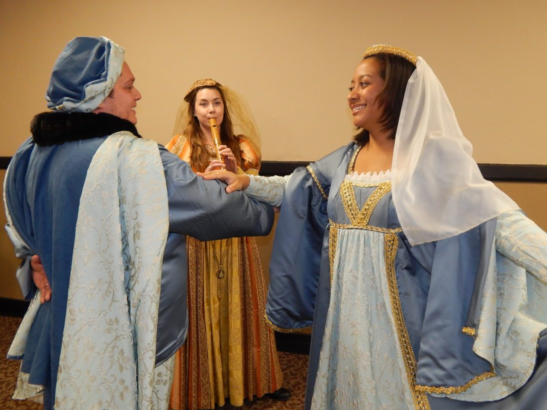 Submitted Photo Matt and Teresa Hargrove and recorder player Courtney Pederson rehearse a court dance for the Minot Chamber Chorale's Renaissance Christmas Feast.