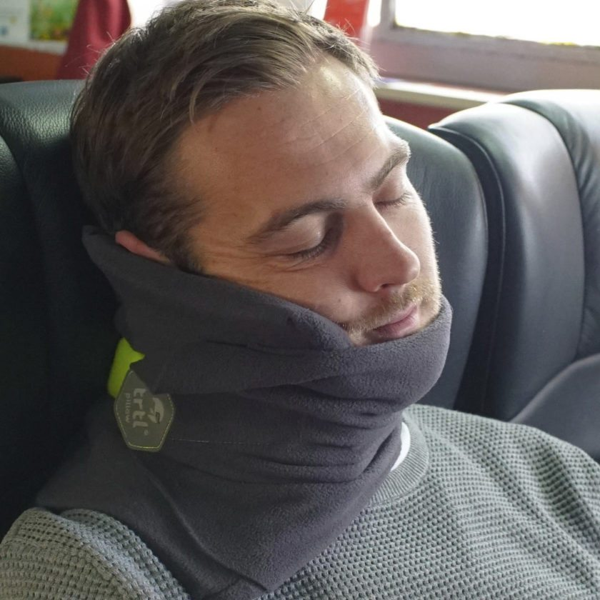 This undated image provided by trtl shows the trtl travel pillow. The trtl pillow supports the head and neck with a system of ribs inside a soft fleece, in a design that is very different from traditional U-shaped travel pillows. (Trtl via AP)