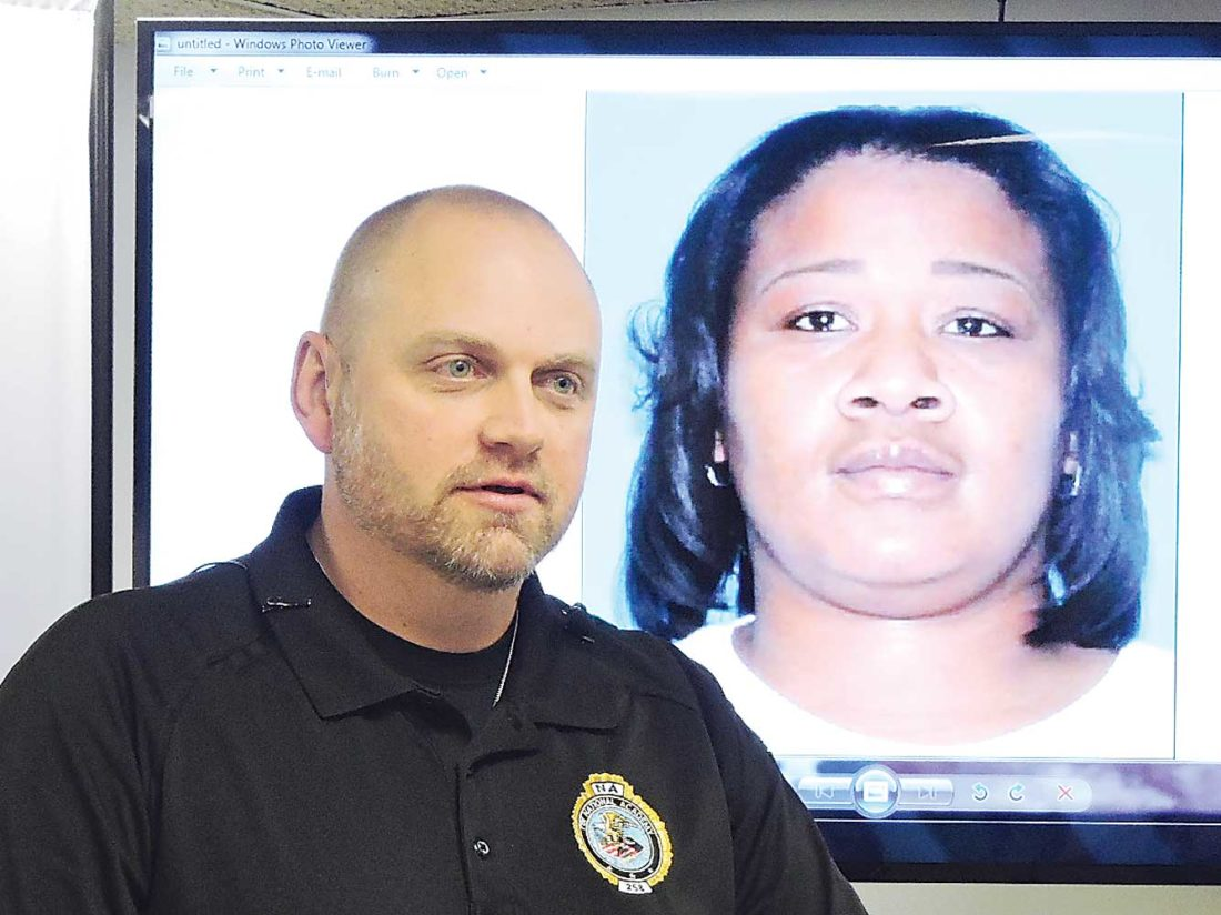 Kim Fundingsland/MDN With a photograph of homicide suspect Kommika Gregory on a screen, Capt. John Klug, Minot Police, provided information to the press about a Thursday morning shooting in south Minot that left one man dead.