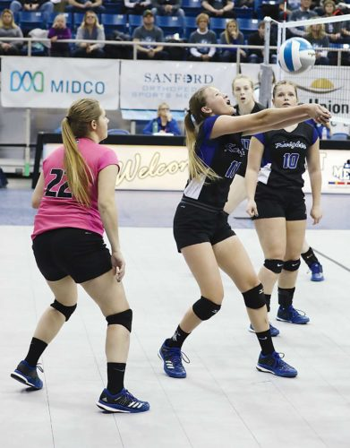 Al Christianson/Special to MDN Knights eighth-grader Eden Olson (11) makes  a dig Thursday in the state tournament at the Fargodome.