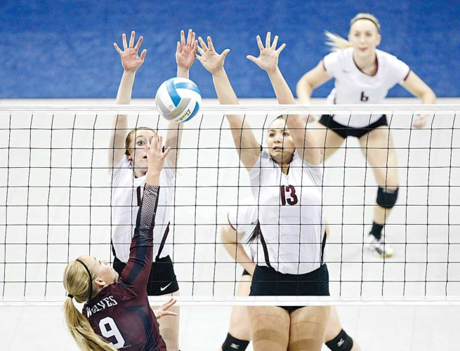 Forum News Service Langdon Area's Rachel Hill and Callie Ronningen defend a shot by Watford City's Mikka Haugeberg Thursday during the North Dakota Class B volleyball tournament at the Fargodome.