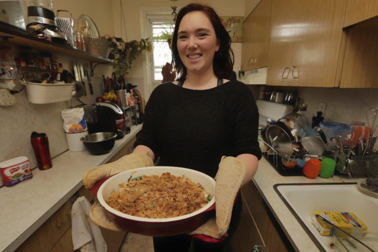 Ruthy Kirwan, of Percolate Kitchen, shows off the her version of the classic Thanksgiving favorite Green Been Casserole, in her apartment kitchen in the Queens borough of New York, Wednesday, Nov. 8, 2017. Before actors perform a play for an audience, they run a dress rehearsal to look for kinks that need fixing before the show opens. Traditional Thanksgiving dinner is a big production that can benefit from rehearsal, too, say some veteran hosts. (AP Photo/Richard Drew)
