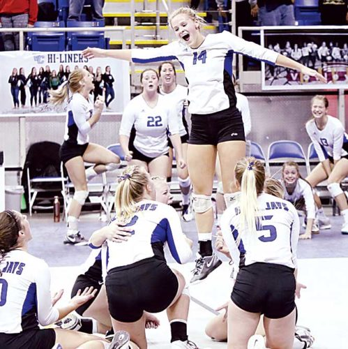 Forum News Service Courtney Peterson of Jamestown leaps in joy after her team defeated Mandan during in semifinal match in the N.D. Class A Volleyball Tournament on Friday in the Fargodome.