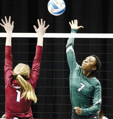 Forum News Service Isatu Shirek of Thompson hits against Langdon-Edmore-Munich during their semifinal match in the N.D. Class B Volleyball Tournament on Friday in the Fargodome.