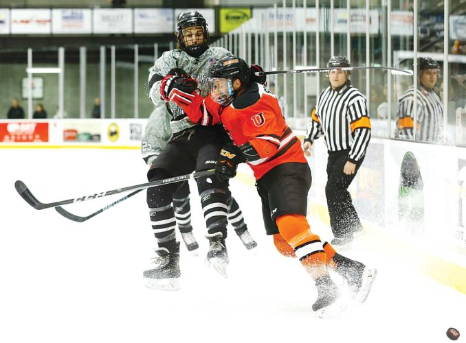 Photos courtesy of Steve Silseth  MSU's Blake Fournier (12) fights for control of the puck during a college hockey game Friday at Maysa Arena.