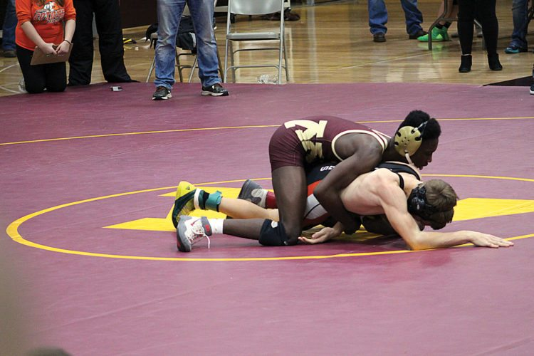 Ashton Gerard/MDN Several Minot High wrestlers compete at the Minot Early Bird wrestling meet Saturday at Magic City Campus. For results, See Page C2.
