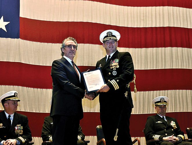 Submitted Photo Gov. Doug Burgum, left, presented a proclamation to Cmdr. Michael Hollenbach, Nov. 9, during the Virginia-class, fast-attack submarine USS North Dakota change of command ceremony, shown in this photo by Mass Communication Specialist 1st Class Steven Hoskins. The proclamation named that day to be USS North Dakota Day.