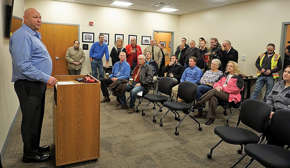 Jill Schramm/MDN Brian Kunz with Adolfson & Peterson Construction speaks at a ribbon-cutting ceremony in the Ward County jail expansion Monday.