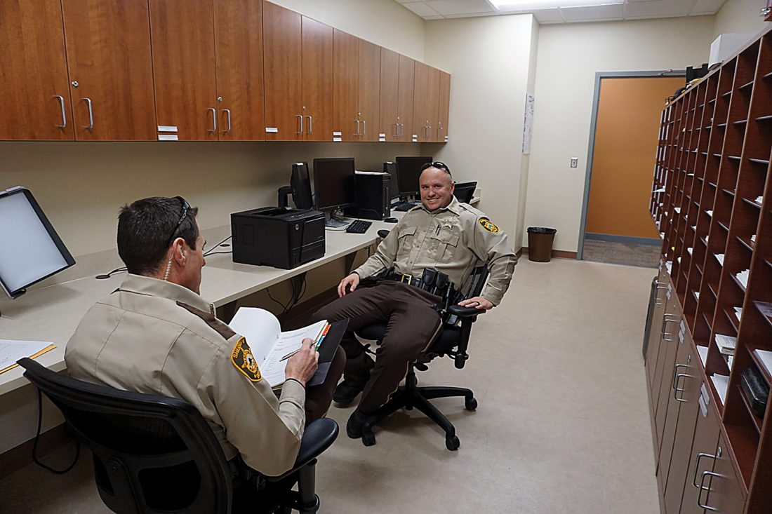 Jill Schramm/MDN Officers work Monday in the night patrol room in the new sheriff's headquarters that are part of the Ward County jail expansion