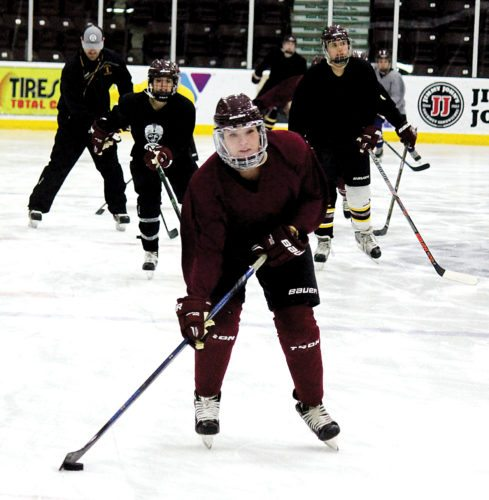 Alex Eisen/MDN The Minot High girls hockey team warms up before practice Monday at Maysa Arena.