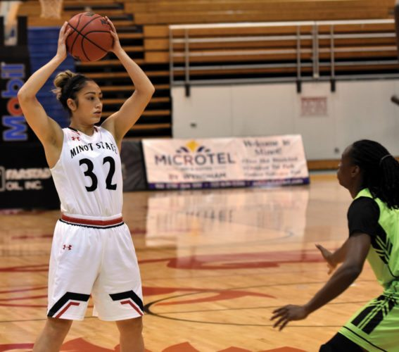 Garrick Hodge/MDN  Minot State's Gabby Wilkinson (32) surveys the passing lanes Wednesday