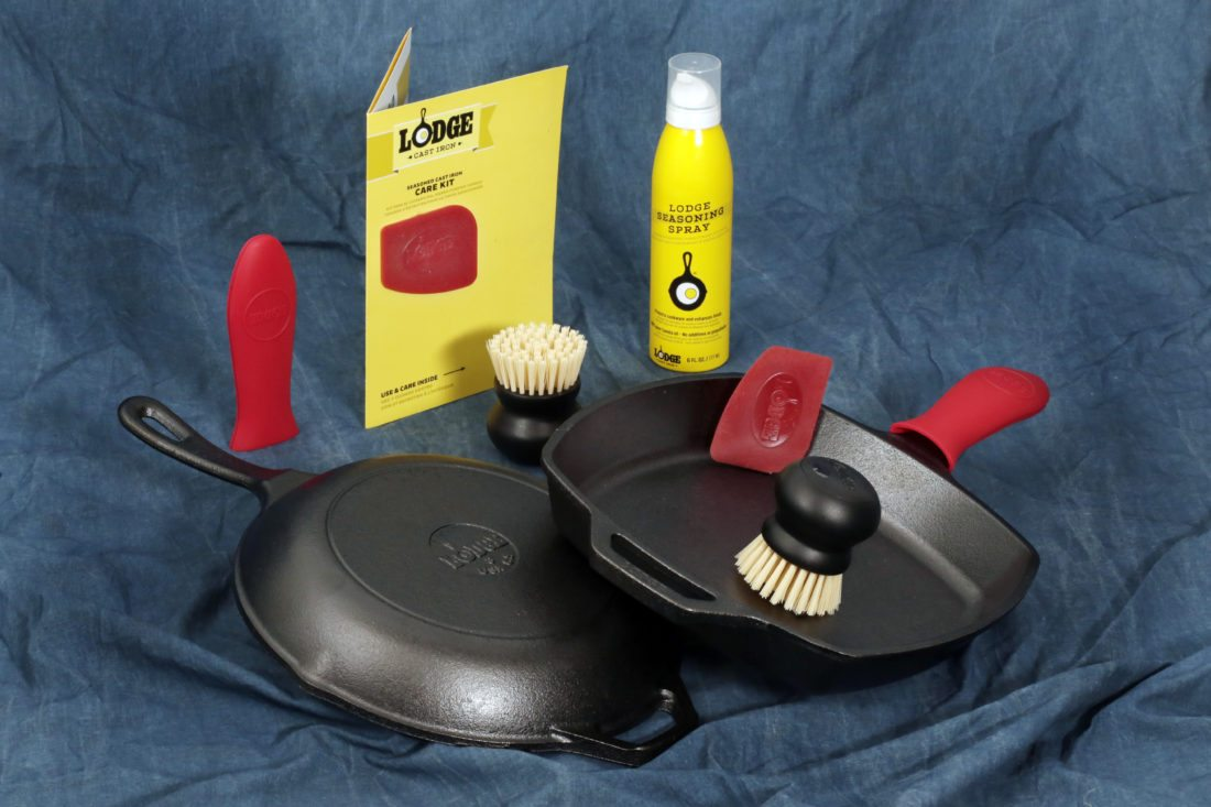 A Lodge Seasoned Cast Iron Care Kit, and two Lodge cast iron skillets, available at shop.lodgemfg.com, are photographed in New York, Thursday, Oct. 2, 2017. Inside the kit are use and care tips, a pan scraper, scrub brush, seasoning spray, and a silicone hot handle holder as a bonus. (AP Photo/Richard Drew)