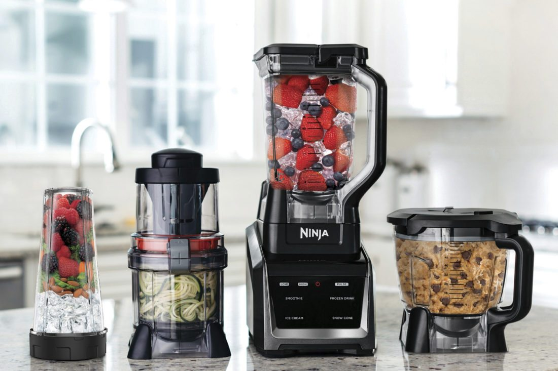 This undated photo provided by SharkNinja Operating LLC shows the Ninja Intelli-Sense Kitchen System. There is one base and four attachments that will blend, chop, make individual smoothies and spiralize. (Michael Piazza/SharkNinja Operating LLC via AP)