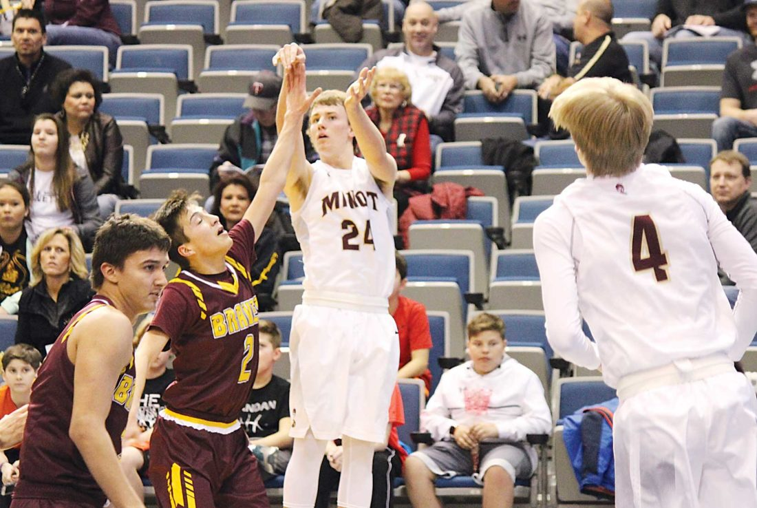 Alex Eisen/MDN Minot High's Peyton Lamoureux (24) takes a shot in a West Region tournament game played last season against Turtle Mountain Community High School.