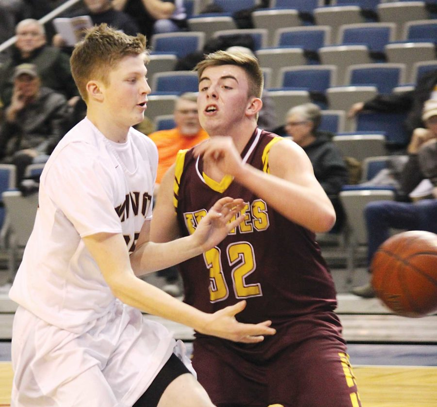 Alex Eisen/MDN Magicians guard Alex Schimke (left) distributes the ball in game played last season at the Bismarck Event Center.