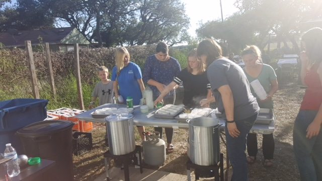 Submitted Photo  Volunteers from Calvary Chapel Minot and Living Word Lutheran Church traveled to Texas over Thanksgiving week to serve food to hurricane victims and to serve up a Thanksgiving dinner at a church there.