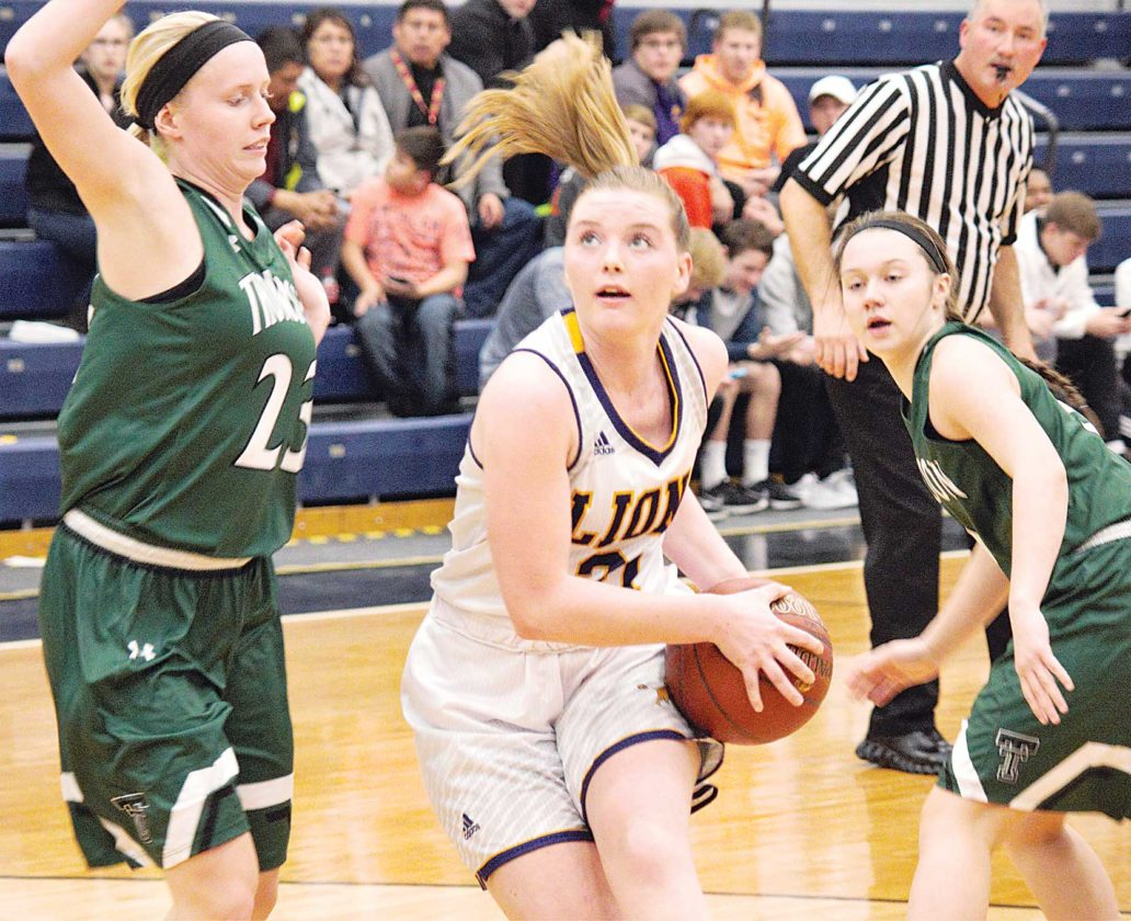 Alex Eisen/MDN Bishop Ryan senior McKinlee Harmon drives to the basket in the Lions season opener against Thompson Friday night at the Minot Municipal Auditorium.