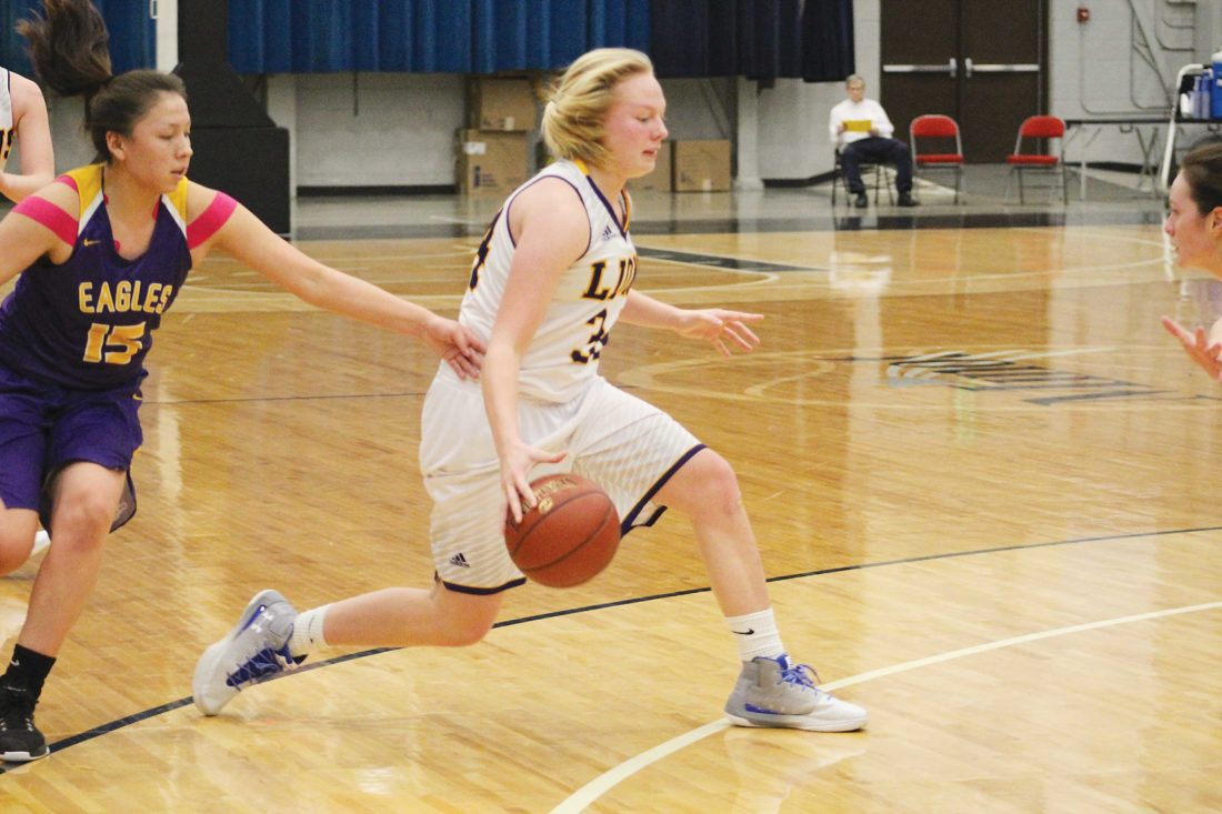 Ashton Gerard/MDN Bishop Ryan sophomore Emma Passa driving through the line in a game against New Town Saturday at the Minot Auditorium. The Lions lost 61-59. Passa scored 11 points for the Lions. Other top scorers for the Lions include McKinlee Harmon with 25 points and Eden Kramer with 10 points.